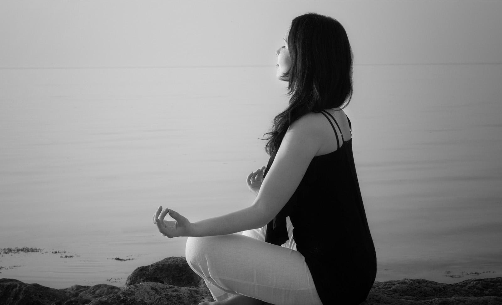Woman sat in meditation pose